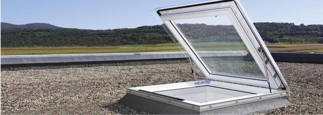 Вікно-вихід Velux для пласкої покрівлі фото